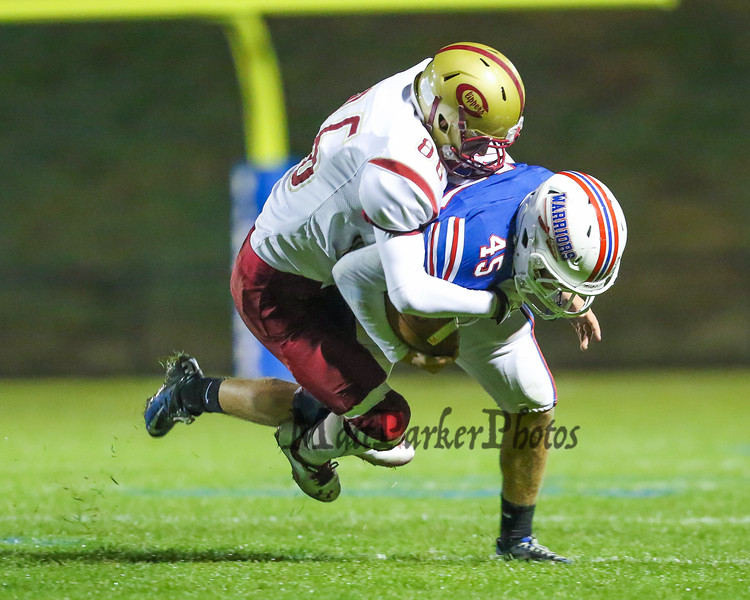 Clippers #86 (unknown) tackles Warriors #45 Liam McNamara during Friday Night's Football game between Winnacunnet and Portsmouth High Schools on 10-16-2015 @ WHS.  Matt Parker Photos