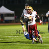 Clippers Quarkerback #9 Cody Graham's foot is grabbed by Warriors #54 Derek Clough preventing Cody from getting into the endzone during Friday Night's Football game between Winnacunnet and Portsmouth High Schools on 10-16-2015 @ WHS.  Matt Parker Photos