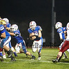 Winnacunnet's #28 Mike Lewis finds the highway open after being cleared by Winnacunnet's #79 Cody Pierce, #54 Derek Clough, #78 Cameron Clark and #70 Patrick Witt during Friday Night's Football game between Winnacunnet and Portsmouth High Schools on 10-16-2015 @ WHS.  Matt Parker Photos