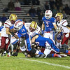 Winnacunnet's #24 Shackiel Boyd gets stopped by Clippers #21 Joey Auger during Friday Night's Football game between Winnacunnet and Portsmouth High Schools on 10-16-2015 @ WHS.  Matt Parker Photos