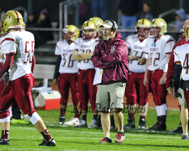 Clippers Coach Brian Pafford calls plays from the sideline during Friday Night's Football game between Winnacunnet and Portsmouth High Schools on 10-16-2015 @ WHS.  Matt Parker Photos