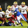 Winnacunnet's #56 Cole Parker tackles Clippers #1 Shone Parham during Friday Night's Football game between Winnacunnet and Portsmouth High Schools on 10-16-2015 @ WHS.  Matt Parker Photos
