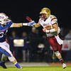 Clippers #21 Joey Auger fends off Warriors #34 Bailey Nasser as he makes his way up field during Friday Night's Football game between Winnacunnet and Portsmouth High Schools on 10-16-2015 @ WHS.  Matt Parker Photos