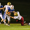Winnacunnet's #28 Mike Lewis's progress is slowed by Clippers #24 Ben Barba during Friday Night's Football game between Winnacunnet and Portsmouth High Schools on 10-16-2015 @ WHS.  Matt Parker Photos