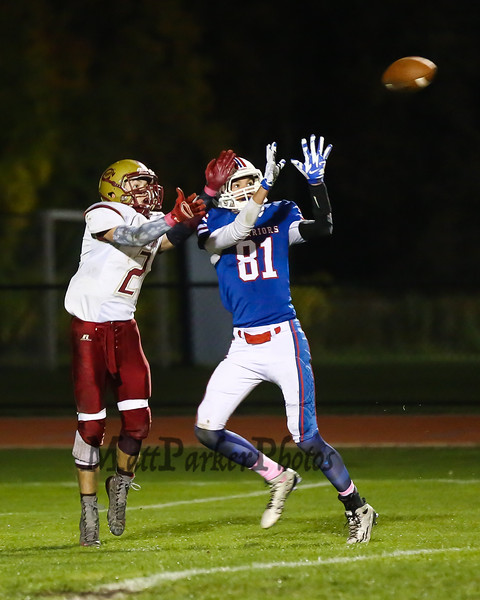 Winnacunnet's #81 Logan Keene breaks up a pass to Clippers receiver #2 Christian Peete during Friday Night's Football game between Winnacunnet and Portsmouth High Schools on 10-16-2015 @ WHS.  Matt Parker Photos