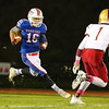 Winnacunnet's #16 Brian Auffant makes a cut to the center of the field to evade Clippers #1 Shone Parham during Friday Night's Football game between Winnacunnet and Portsmouth High Schools on 10-16-2015 @ WHS.  Matt Parker Photos
