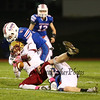 Clippers #1 Shon Parham is tackled by Warriors #81 Logan Keene and #28 Mike Lewis after gain some rushing yards during Friday Night's Football game between Winnacunnet and Portsmouth High Schools on 10-16-2015 @ WHS.  Matt Parker Photos