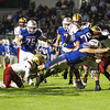 Winnacunnet's #28 Mike Lewis's stretches to put the ball over the goal line for a touchdown with Clippers #1 Shon Parham holding on and Winnacunnet's #79 Cody Pierce blocking during Friday Night's Football game between Winnacunnet and Portsmouth High Schools on 10-16-2015 @ WHS.  Matt Parker Photos