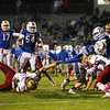 Winnacunnet's #28 Mike Lewis's runs in for a touchdown while being dragged down by Clippers #54 Alex Gladu with #1 Shon Parham getting in on the play during Friday Night's Football game between Winnacunnet and Portsmouth High Schools on 10-16-2015 @ WHS.  Matt Parker Photos