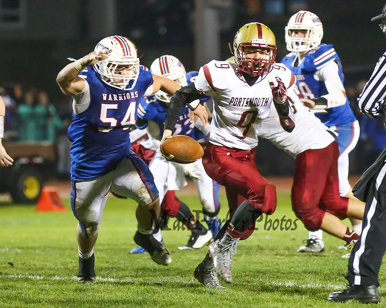 Clippers Quarkerback #9 Cody Graham runs the ball with Warriors #54 Derek Clough on his tail during Friday Night's Football game between Winnacunnet and Portsmouth High Schools on 10-16-2015 @ WHS.  Matt Parker Photos