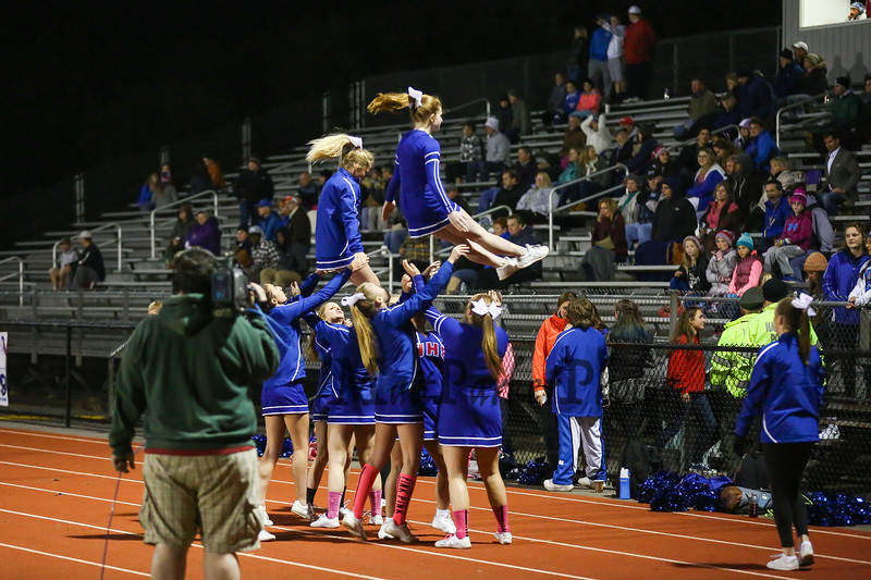 Winnacunnet Warriors Cheerleaders entertain the fans at the Boys Varsity Football vs the Clippers of Portsmouth High School Friday Night Lights game on 10-16-2015 @ WHS. WHS-55, PHS-7 Matt Parker Photos