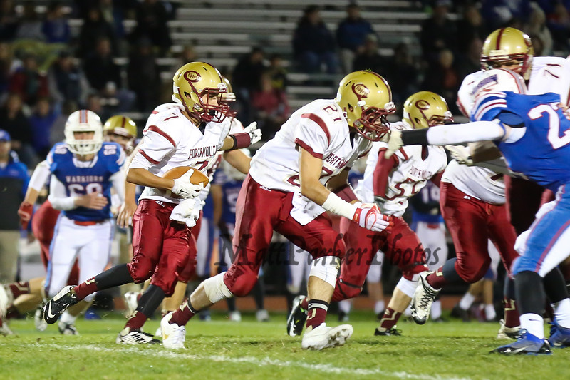 Clipper's #7 Jake Lorenz follows blocking by teammate #21 Joey Auger to gain some rushing yards during Friday Night's Football game between Winnacunnet and Portsmouth High Schools on 10-16-2015 @ WHS.  Matt Parker Photos