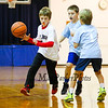 Bean Insurance/Villanova's #1 dribbles around Tri Rent All/North Carolina's #1 and #24 during a 5th and 6th Grade Coed Basketball Game @ Marston School  in Hampton on Saturday 11-21-2015.  Matt Parker Photos