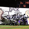 The Marshwood Hawks break through a banner being held by the Marshwood Cheering Squad prior to the start of the Maine Principals Association Class B Football State Championships between Marshwood and Brunswick High Schools on Saturday @ Fitzpatrick Stadium, Portland, ME, 11-21-2015, MHS-21, BHS-14.  Matt Parker Photos