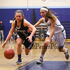 York's #3 Lily Posternak gets her hand on the ball but is called for a foul as Raiders #22 Julia Quinn goes in for a layup during Saturday's Western Maine Conference Girls Basketball game between York and Fryeburg Academy @ York on 12-19-2015.  Matt Parker Photos