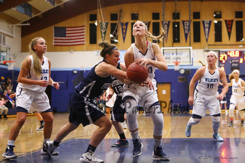 York's #20 Chloe Smedley gets fouled by Raiders #11 Katherine Parker as she drives to the hoop for a layup during Saturday's Western Maine Conference Girls Basketball game between York and Fryeburg Academy @ York on 12-19-2015.  Matt Parker Photos