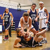 York Wildcats #21 Emma Thomson gets her hands on a loose ball with Raider's #15 Alexis L'Heureux-Carland during Saturday's Western Maine Conference Girls Basketball game between York and Fryeburg Academy @ York on 12-19-2015.  Matt Parker Photos