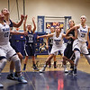 York's #21 Emma Thomson and #20 Chloe Smedley box out Raiders #12  Sage Boivin on a shot by Raiders #22 Julia Quinn during Saturday's Western Maine Conference Girls Basketball game between York and Fryeburg Academy @ York on 12-19-2015.  Matt Parker Photos