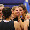 Winnacunnet's Girls Varsity Coach Cassiopeia Turcotte has some laughs with her players during Wednesday's Girls Basketball Tryouts at WHS on 12-2-2015.  Matt Parker Photos