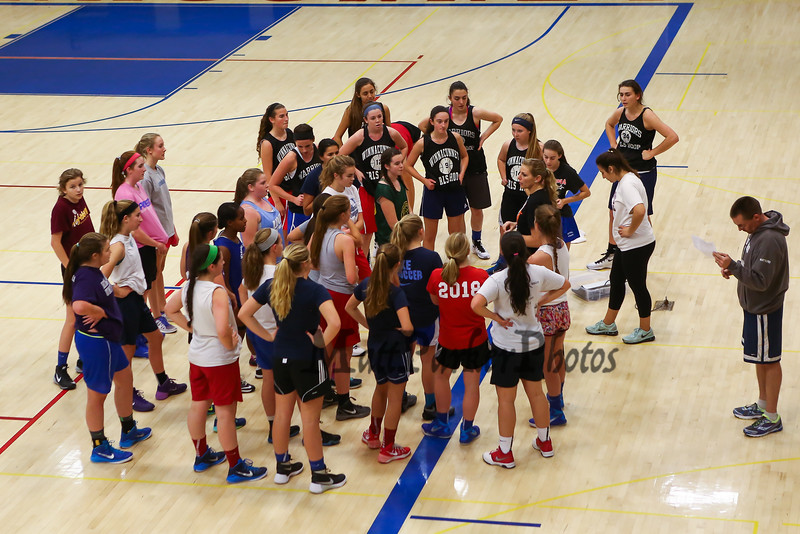 Winnacunnet's Girls Varsity Coach Cassiopeia Turcotte talks with the players at Wednesday's Girls Basketball Tryouts at WHS on 12-2-2015.  Matt Parker Photos