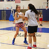 Winnacunnet's Audrey Notargiacomo sets a screen for Alexa Cestrone during Wednesday's JV Girls Basketball Tryouts at WHS on 12-2-2015.  Matt Parker Photos