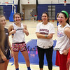 Winnacunnet's Girls Junior Varsity Coach Aubrey Palacio and her players share a laugh at Wednesday's Girls Basketball Tryouts at WHS on 12-2-2015.  Matt Parker Photos