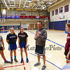 Winnacunnet's Girls Freshman Coach Tom Hayward speaks with his players at Wednesday's Girls Basketball Tryouts at WHS on 12-2-2015.  Matt Parker Photos