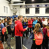 Winnacunnet's Coach John Hodsdon (center red) talks with the Girls team after Sunday's Indoor Winter Track Meet @ the Paul Sweet Oval at UNH on 12-20-2015.  Matt Parker Photos