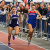 Winnacunnet's Sarah DeMello edges out Nashua South's Vanessa Norton in the girls 4x400m relay at Sunday's Indoor Winter Track Meet @ the Paul Sweet Oval at UNH on 12-20-2015.  Matt Parker Photos