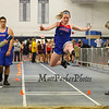 Winnacunnet's Erin Sullivan leaps for distance in the girls long jump at Sunday's Indoor Winter Track Meet @ the Paul Sweet Oval at UNH on 12-20-2015.  Matt Parker Photos
