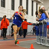 Winnacunnet's Meaghan Kacmarcik (6th 3:35.60) rounds the track in the Girls 1000m run at Sunday's Indoor Winter Track Meet @ the Paul Sweet Oval at UNH on 12-20-2015.  Matt Parker Photos