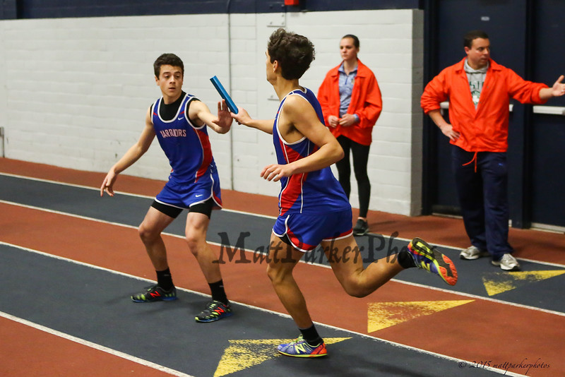 Winnacunnet's Xavier Coggeshall hands the batton off to Matt Gigliotti in the boys 400m Relay at Sunday's Indoor Winter Track Meet @ the Paul Sweet Oval at UNH on 12-20-2015.  Matt Parker Photos