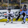 UNH's #25 Chris Miller makes a break for the puck with Black Bears #14 Cedric LaCroix trailing during Tuesday's DIV I Mens Hockey game between the UNH Wildcats and Maine Black Bears @ Cross Insurance Arena, Portland ME. on 12-29-2015.  Matt Parker Photos