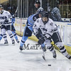 UNH Defender #27 Matt Dawson controls the puck with Black Bears #88 Brian Morgan trailing during Tuesday's DIV I Mens Hockey game between the UNH Wildcats and Maine Black Bears @ Cross Insurance Arena, Portland ME. on 12-29-2015.  Matt Parker Photos