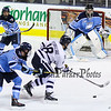 UNH's #18 Andrew Poturalski lines up for a shot with Black Bears Goalie #35 Rob McGovern and #89 Blaine Byron defending during Tuesday's DIV I Mens Hockey game between the UNH Wildcats and Maine Black Bears @ Cross Insurance Arena, Portland ME. on 12-29-2015.  Matt Parker Photos