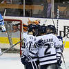 UNH celebrates after teamamte #21 John Furgele's goal during Tuesday's DIV I Mens Hockey game between the UNH Wildcats and Maine Black Bears @ Cross Insurance Arena, Portland ME. on 12-29-2015.  Matt Parker Photos