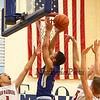 Winnacunnet's #3 Liam Viviano goes up strong for a basket with Spaulding defending during Wednesday's Final Boys Basketball game between Winnacunnet and Spaulding High Schools at the 2015 5th Annual Boys and Girls Bobcat Invitational Basketball Tournament @ Oyster River HS on 12-30-2015.  Matt Parker Photos