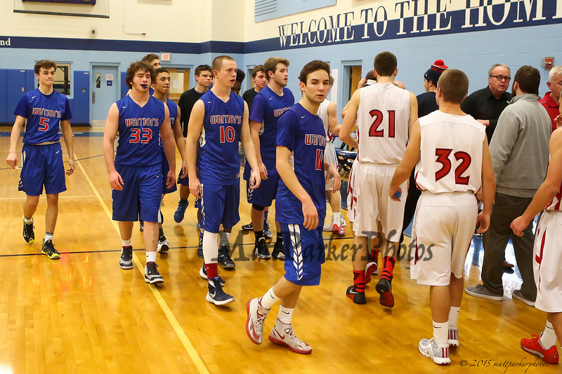 Winnacunnet players head off the court after Spaulding's win in Wednesday's Final Boys Basketball game between Winnacunnet and Spaulding High Schools at the 2015 5th Annual Boys and Girls Bobcat Invitational Basketball Tournament @ Oyster River HS on 12-30-2015.  Matt Parker Photos