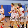 Spaulding players congratulate each other after winning Wednesday's Final Boys Basketball game between Winnacunnet and Spaulding High Schools at the 2015 5th Annual Boys and Girls Bobcat Invitational Basketball Tournament @ Oyster River HS on 12-30-2015.  Matt Parker Photos