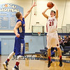 Spaulding's #21 Cal Connelly takes a jump shot with Winnacunnet's #10 James Morse defending during Wednesday's Final Boys Basketball game between Winnacunnet and Spaulding High Schools at the 2015 5th Annual Boys and Girls Bobcat Invitational Basketball Tournament @ Oyster River HS on 12-30-2015.  Matt Parker Photos
