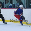 Winnacunnet's #3 Meg Dzialo clear the puck behind the WHS net with Kennett Eagles players chasing during the 39th Annual Hockey Jamboree at the Dover Ice Arena on Saturday 12-5-2015.  Matt Parker Photos