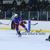 Winnacunnet's #9 James Nash takes a shot with #16 Brian Auffant during the 39th Annual Hockey Jamboree at the Dover Ice Arena on Saturday 12-5-2015.  Matt Parker Photos