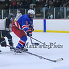 Winnacunnet's #9 James Nash keeps ahead of Kennett Eagles players  as he makes a run at the goal during the 39th Annual Hockey Jamboree at the Dover Ice Arena on Saturday 12-5-2015.  Matt Parker Photos
