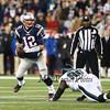Patriots QB #12 Tom Brady scrambles to get free of Eagles DT #96 Bennie Logan during Sunday's NFL Football game between the New England Patriots and Philadelphia Eagles on 12-6-2015 @ Gillette Stadium, Foxborough MA.  Matt Parker Photos