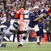 Patriots QB #12 Tom Brady scrambles to elude Eagles DE #91 Fletcher Cox during Sunday's NFL Football game between the New England Patriots and Philadelphia Eagles on 12-6-2015 @ Gillette Stadium, Foxborough MA.  Matt Parker Photos