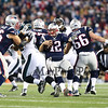 Patriots QB #12 Tom Brady uses blocking by Offensive Line Men #66 Bryan Stork and #67 Josh Klines to gain yards during Sunday's NFL Football game between the New England Patriots and Philadelphia Eagles on 12-6-2015 @ Gillette Stadium, Foxborough MA.  Matt Parker Photos