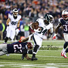 Patriots Safety #23 Patrick Chung gets a hold of Eagles RB #34 Jenjon Barner on a running play at Sunday's NFL Football game between the New England Patriots and Philadelphia Eagles on 12-6-2015 @ Gillette Stadium, Foxborough MA.  Matt Parker Photos