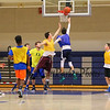 Winnacunnet Sophmore Johnny Cadagan takes the ball to the hoop with Junior Freddy Schaake defending during Wednesday's preseason  Varsity and JV Boys Basketball session on 12-9-2015 @ WHS.  Matt Parker Photos