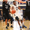 UNH's #0 Jaleen Smith gets a pass off while Binghamton's #42 Willie Rodriguez and #12 John Rinaldi close in to defend during Saturday's American East Men's Basketball game between The University of New Hampshire and Binghamton University @ UNH's Lundholm Gymnasium on 2-14-2015.   Quinn Parker Photos
