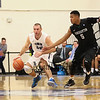 UNH's #30 Joe Bramanti gets pressure from Binghamton's #5 Magnus Richards full court press during Saturday's American East Men's Basketball game between The University of New Hampshire and Binghamton University @ UNH's Lundholm Gymnasium on 2-14-2015.   Matt Parker Photos